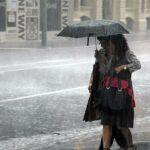 36661062-9036605-Businesswomen_shelter_under_an_umbrella_during_a_storm_in_Brisba-a-12_1607556995960